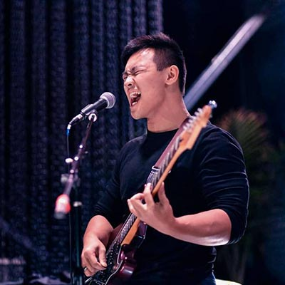 Tre Pham, guitar and bass instructor