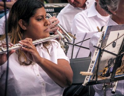 Woman plays flute in orchestra
