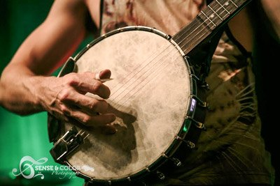 Closeup of man playing banjo